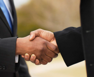 two hands in a handshake/ loyalty programs