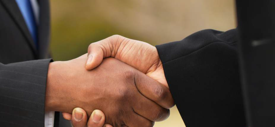 two hands in a handshake. converting comlaining customers to loyal customers